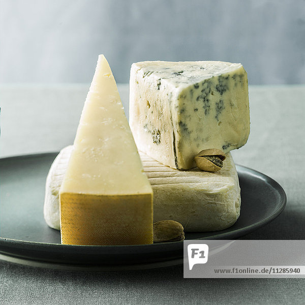 Wedges of cheese on plate