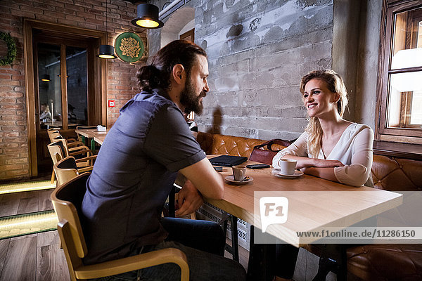 Couple in coffee shop having a conversation