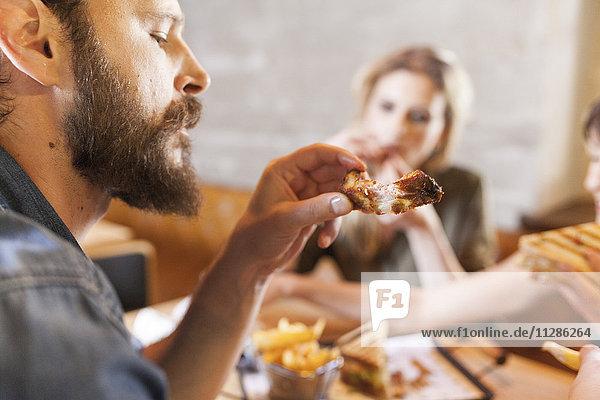 Friends in coffee shop eating snacks