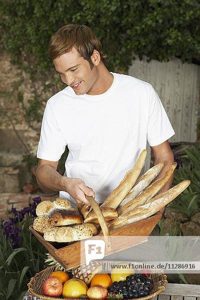 Man Holding Basket of Bread