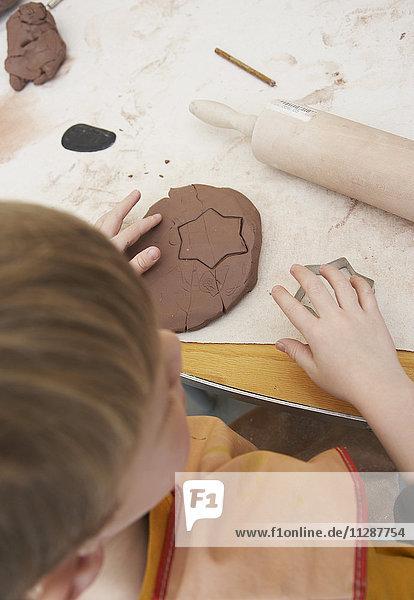 Boy in Pottery Studio