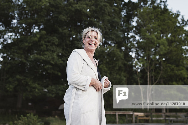 Laughing woman in dressing gown