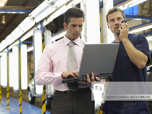 Men in Automotive Plant