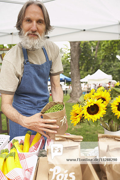 Grocer at Farmers Market