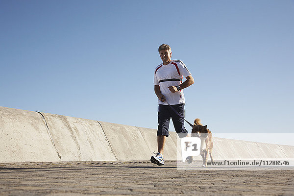 Man Jogging with Dog
