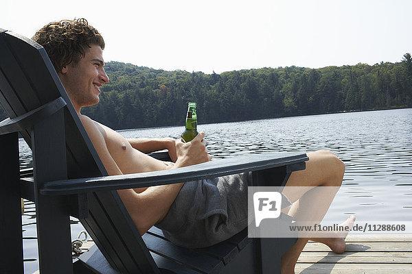 Man Relaxing on Dock