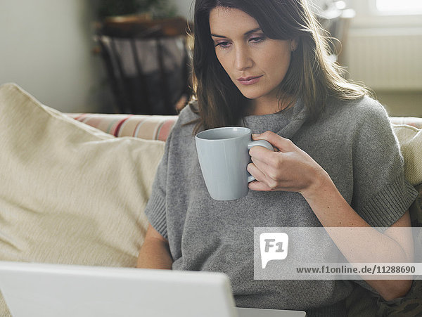 Portrait of Woman using Laptop Computer