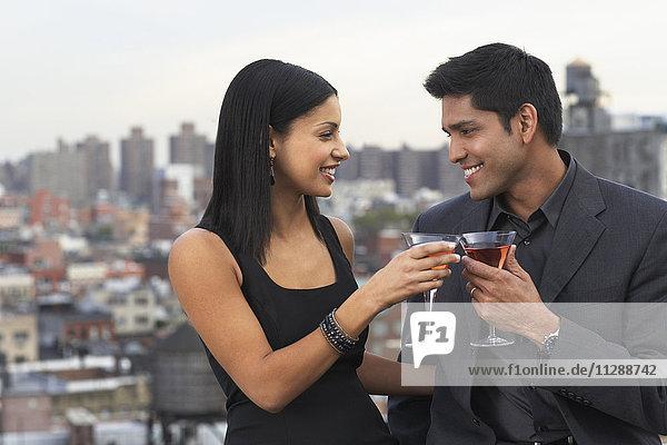 Couple Drinking Wine on Balcony  Soho  New York City  New York  USA