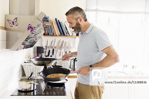 Smiling man cooking