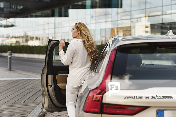Woman leaving car