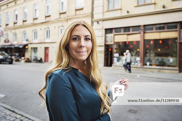 Portrait of woman on street