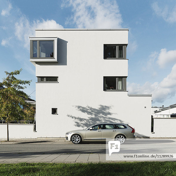 Car in front of modern house
