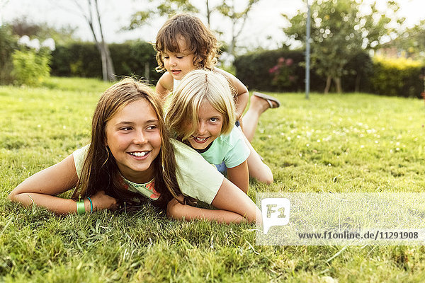 Three girls having fun together on a meadow