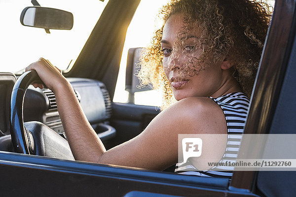 Portrait of young car driver