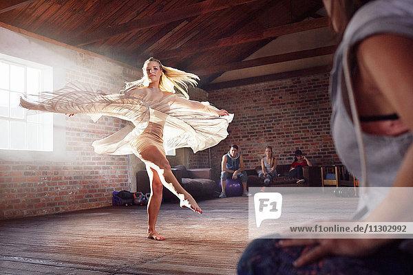 Graceful dancer dancing in studio