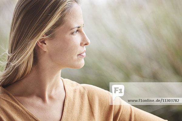 Close up pensive blonde woman looking away