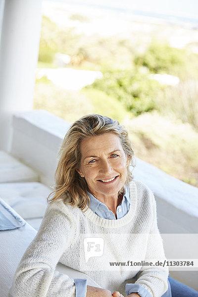 Portrait smiling senior woman on patio
