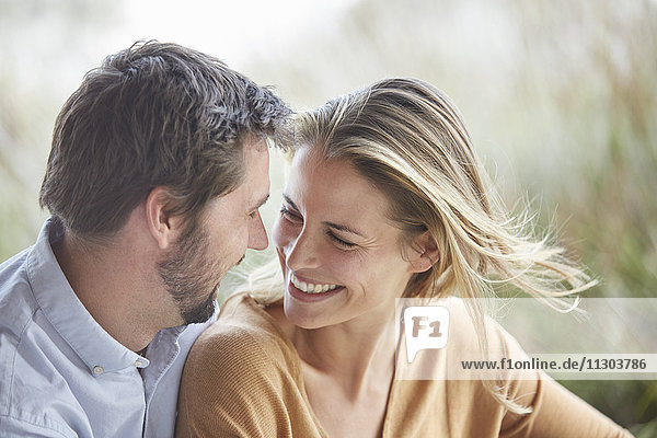 Smiling affectionate couple face to face