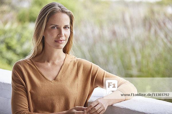 Portrait serene woman on patio