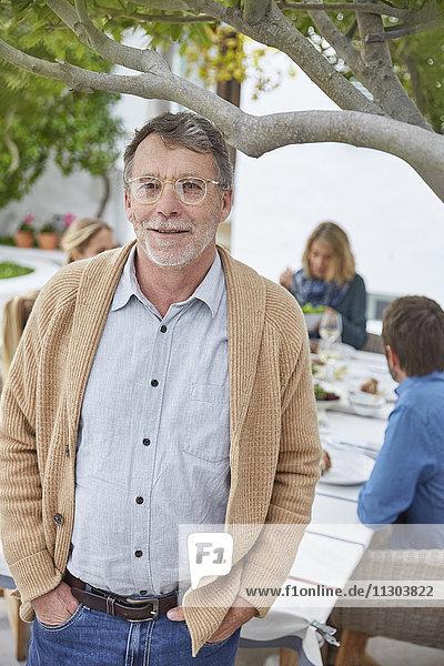 Portrait smiling senior man on patio