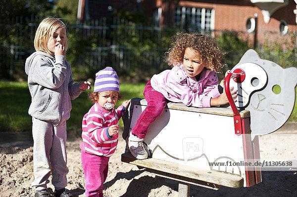 Three girls playing on playground