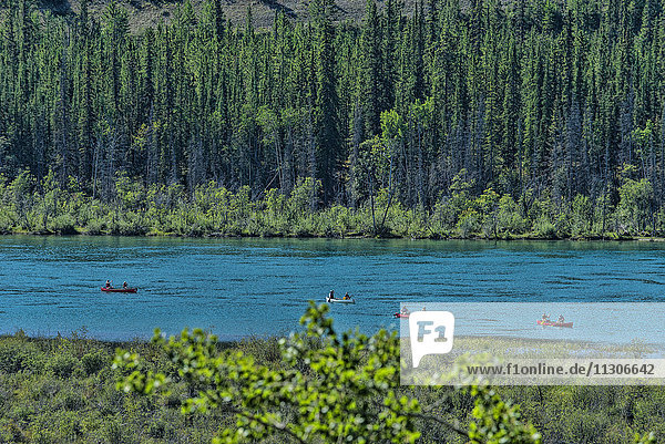 canoeists on Yukon river  Canada