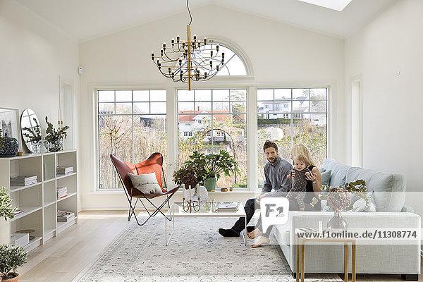 Family in modern living room