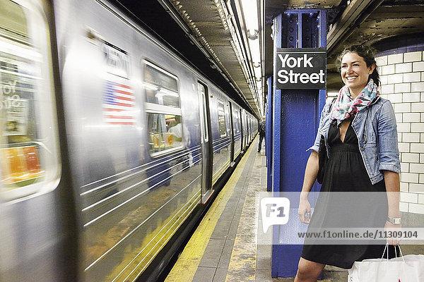 Smiling woman on subway platform