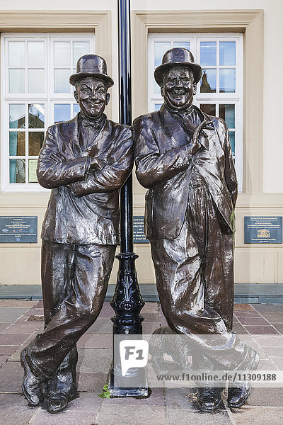 England  Cumbria  Lake District  Ulverston  Statue of Laurel and Hardy in front of The Coronation Hall Theatre