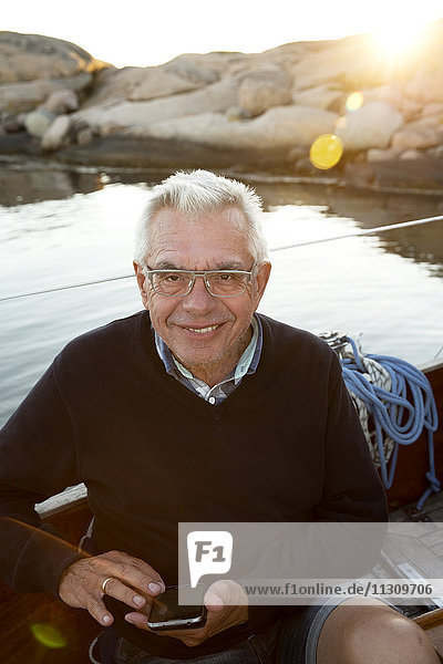 Portrait of senior man on boat