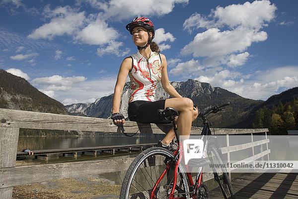 Bike  bicycle  scenery  Salzburg  Austria  helmet  bike  summer  lake  Aussee  sport  rest  fun  helmet  joy  woman  footbridge
