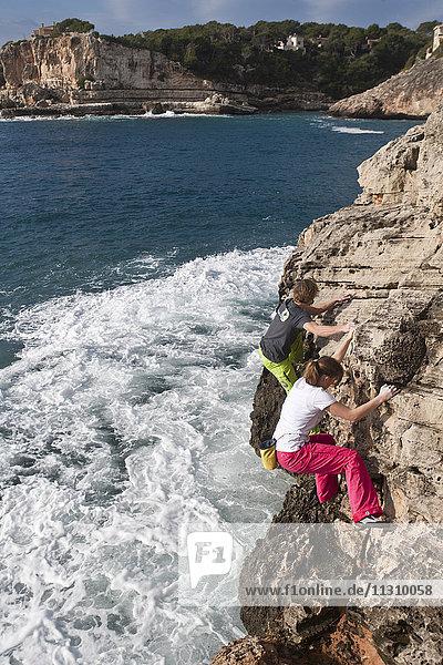 Majorca  Spain  climbing  free climbing  man  woman  couple  sport  boulder  no rope Majorca, Spain, climbing, free climbing, man, woman, couple, sport, boulder, no rope,
