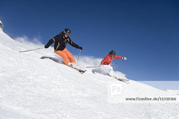 Austria  Obertauern  man  woman  slope  ski  skiing  Carving  sport  winter