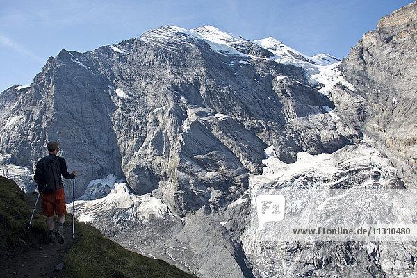 Switzerland  Europe  Bernese Oberland  Kiental  Alps  mountain  Wildi Frau  hiker  summer  sticks
