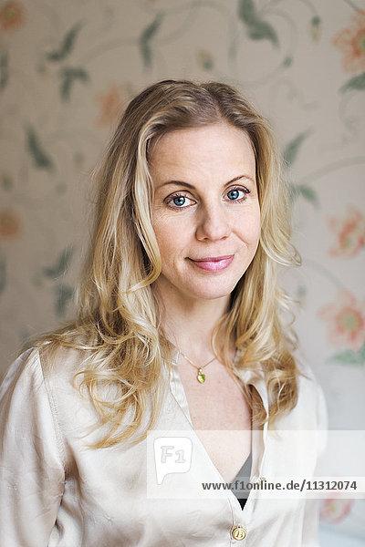 Portrait of mid-adult woman indoors