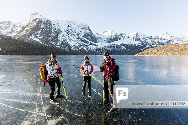 Portrait of ice skaters on frozen lake