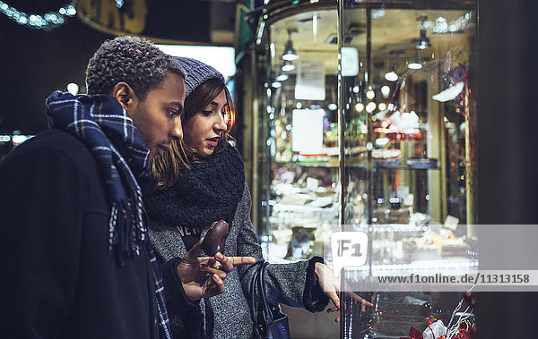 Young couple looking in shop window