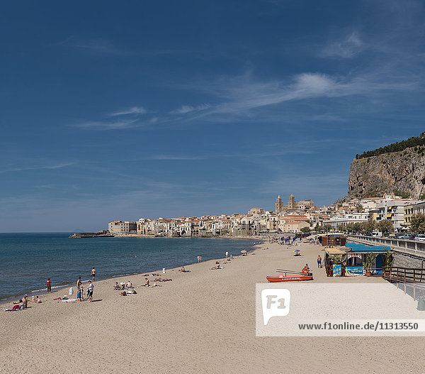 From the beach a view of the town and the Rocca de Cefalu
