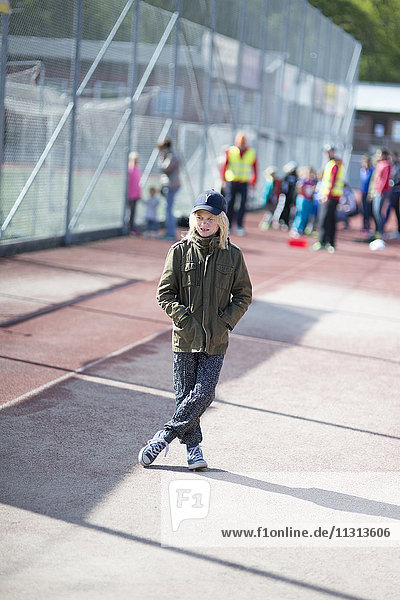 Girl standing by playing field
