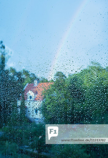 Rainbow seen through wet glass