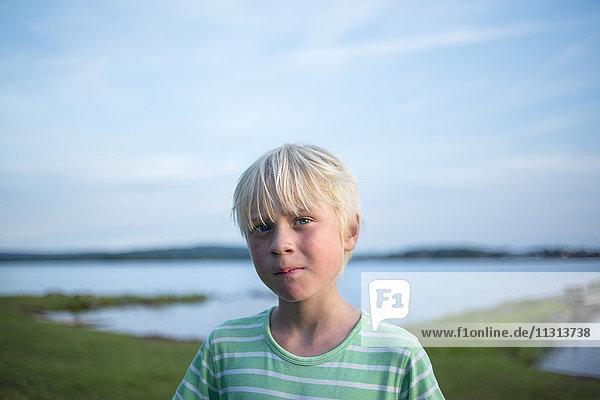 Portrait of boy by lake