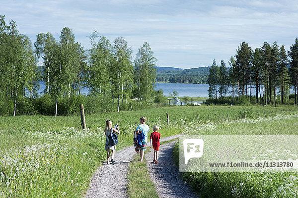 Children walking in dirt road