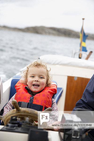 Cute girl driving boat