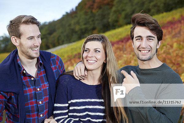 Happy friends in a vineyard