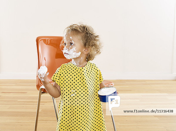 Little girl with cream on her face