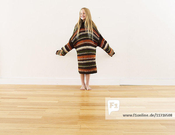 Girl wearing oversized knit pullover