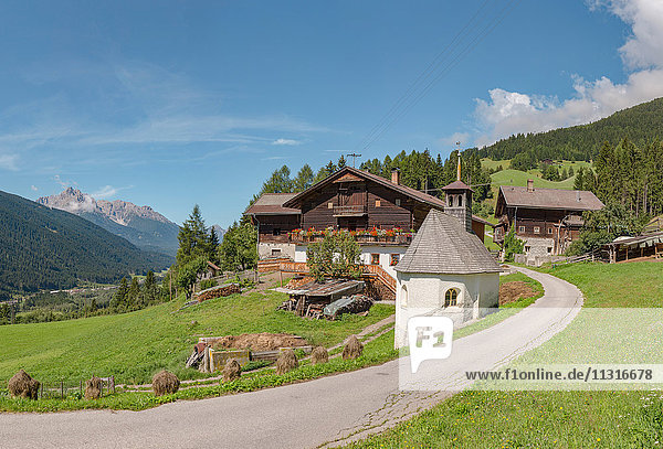 Sillian  Austria  Farmhouse and chapel at mountain Sillianberg