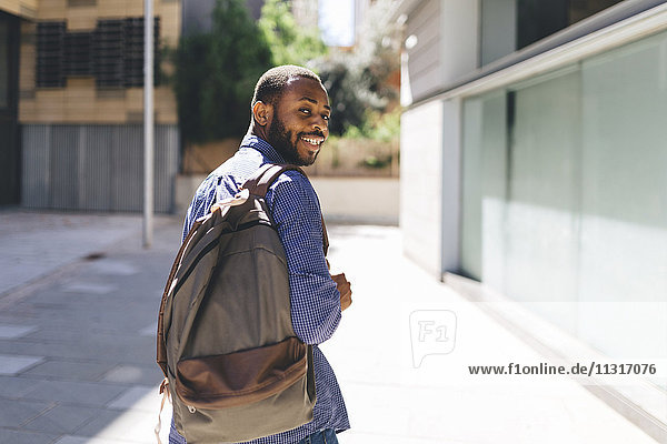 Smiling man with backpack