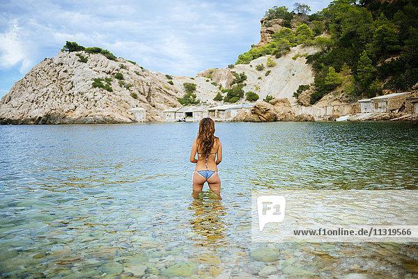 Spian  Ibiza  Woman standing in water at Llentrisca bieach