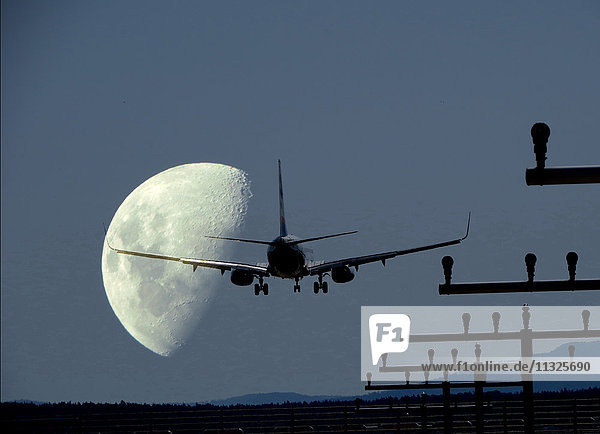landing jet and moon